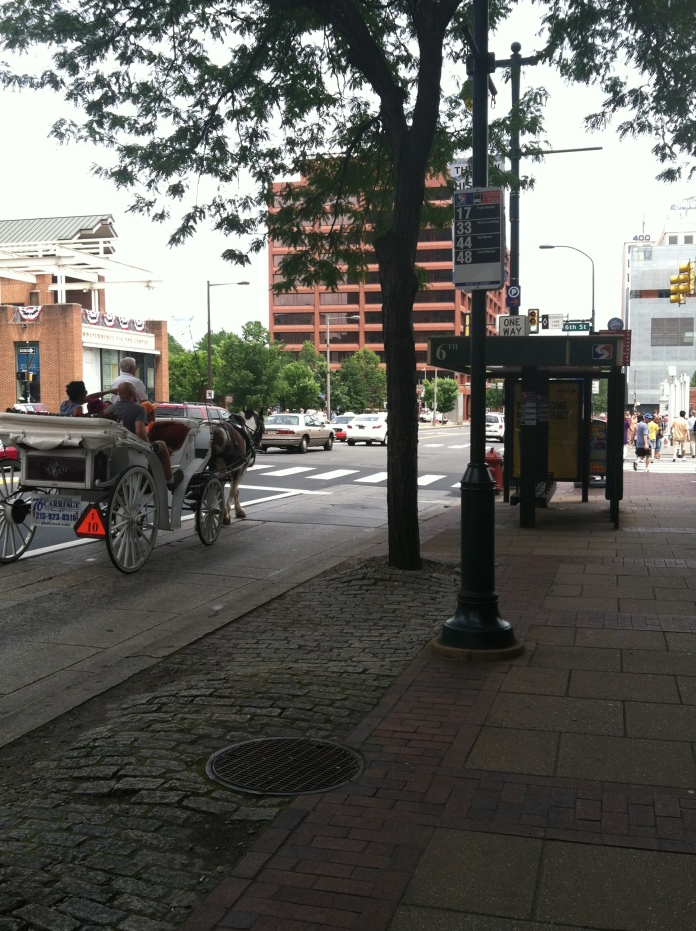 The first thing I see when I get off the bus is a horse drawn carriage! Horses are my totem animal so this was a good omen for sure. I had plans to meet a few people before I went to cover the Ice Cube show, so I hopped off and let God show me the way!